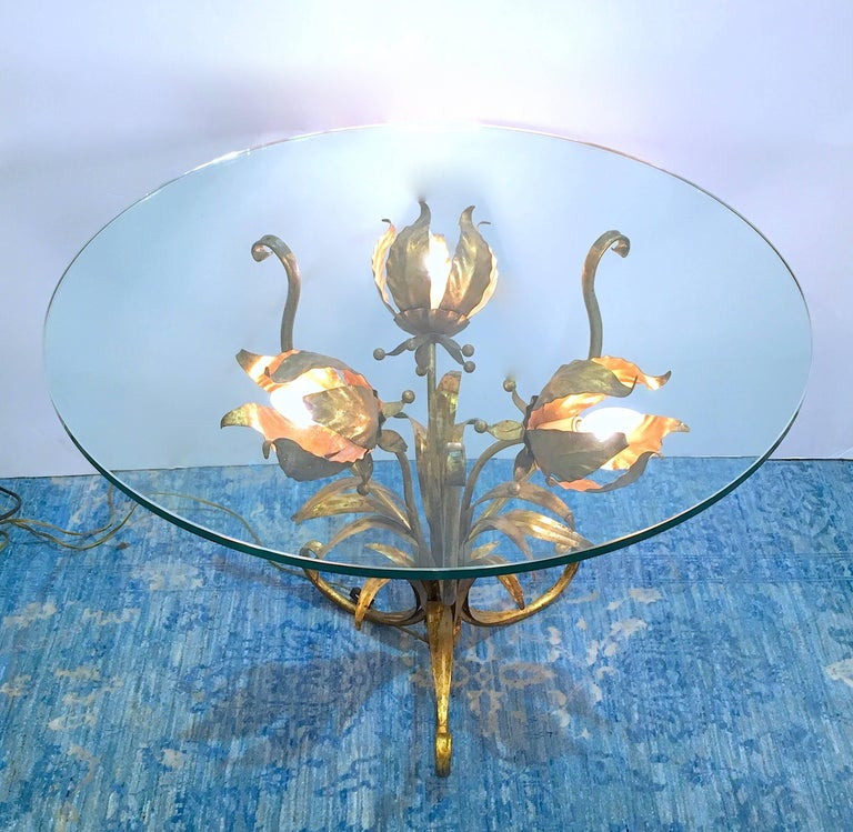 Side or end table with a sculptural gilt tole base with three flowers. Each flower is illuminated and the effect is lovely. Please contact for location.