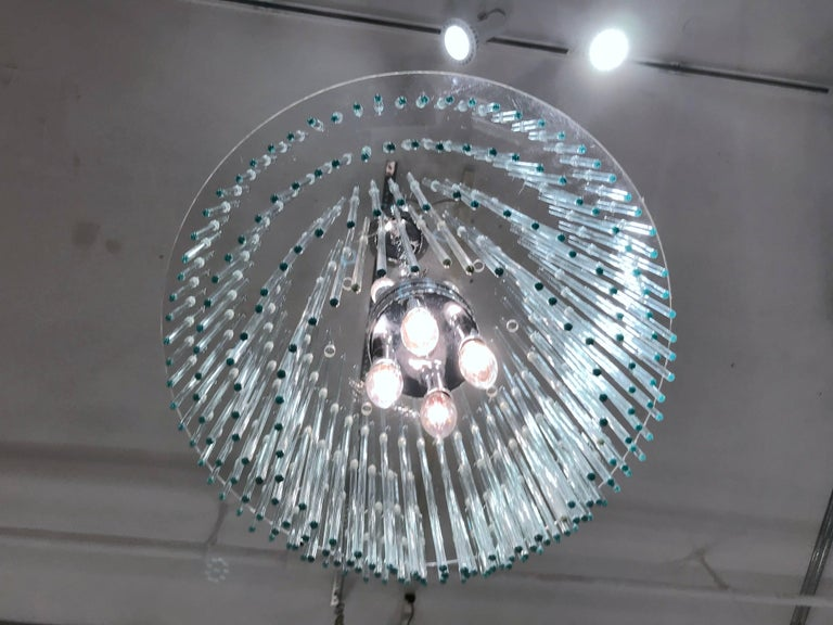 Wonderful chandelier with a Lucite armature and crystal rods that are arranged in several tiers. The light sockets are finished in polished chrome. Please contact for location.