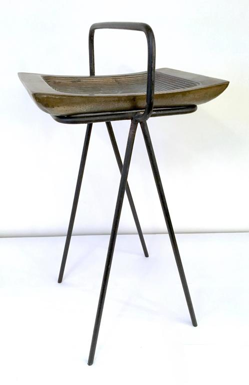 A striking modernist smoking stand by artist Ben Seibel. A sculptural ashtray of composite metals rests within an iron stand. Please contact for location.