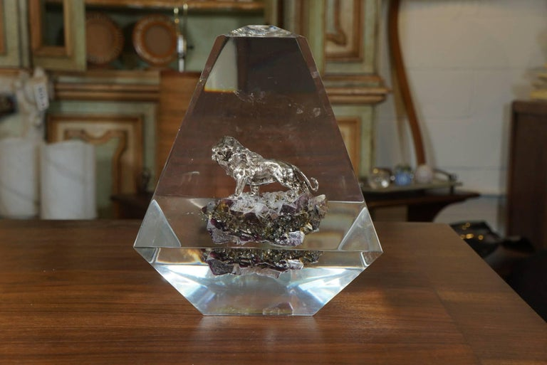 Here is an amazing lucite obelisk sculpture with an encased silver lion standing on an amethyst specimen. Thoroughly modern, this piece is in the style of Allesandro Albrezzi and Pierre Geuridon.
