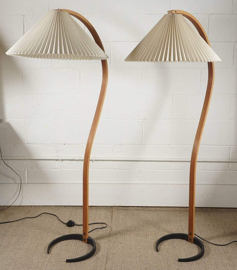 Here is a single Caprani standing lamp with a bentwood base. The pleated shades are original and in very clean condition. The base is iron with the mark Caprani.