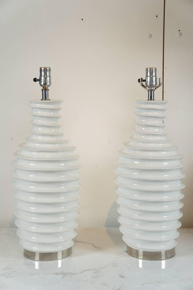 American Pair of White Porcelain Lamps with Spiral Motif For Sale