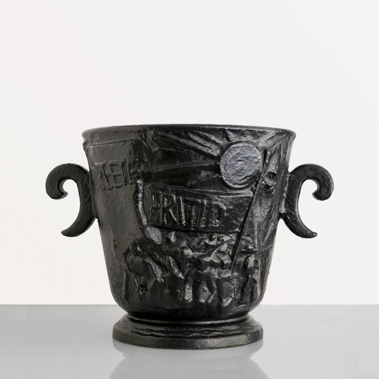 "A large Scandinavian Modern cast iron ""Leisure Urn"" depicting cultural arts on one side and the demand for social change during the 1930s. One side has marching workers carrying banners which read ""Arbete Fritid"" the other side"