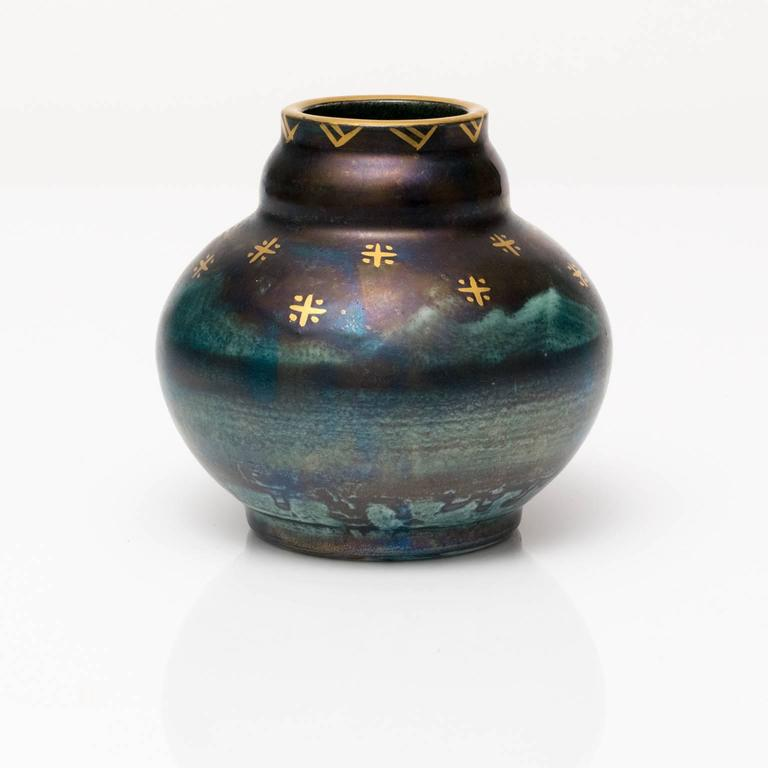 """A small Scandinavian Modern, Art Deco ceramic vase with blue luster detailed in gold. Designed by Josef Ekberg for Gustavsberg, signed and dated 1928.   Measures: Height 3.5"""", diameter 4""""."""