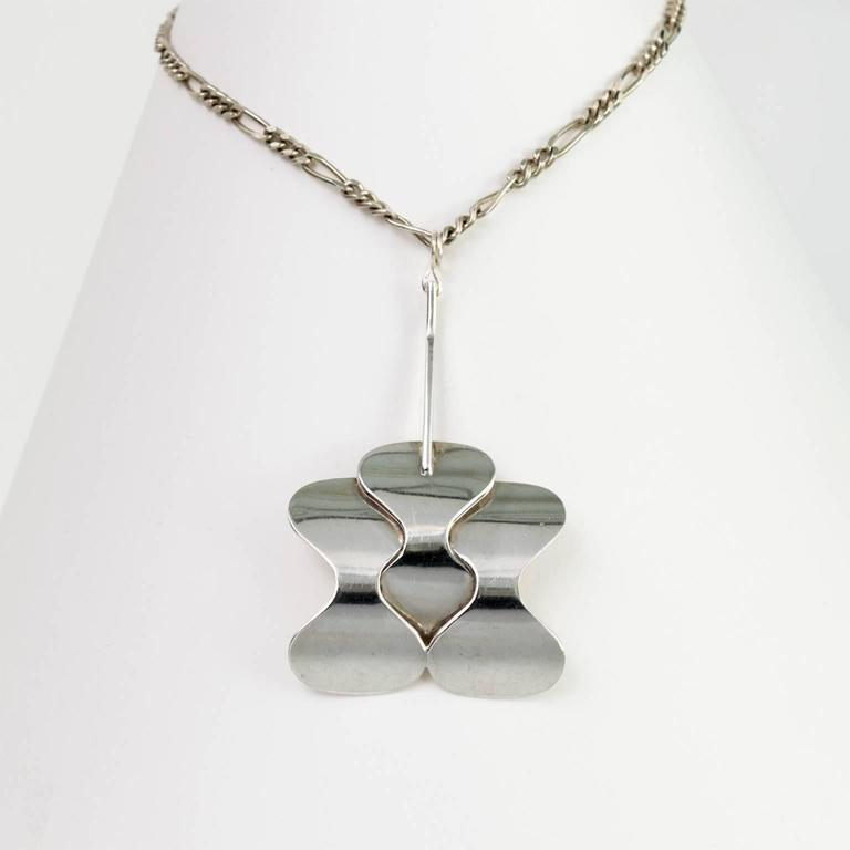 "Silver Scandinavian Modern pendant with three soft curves shapes and silver chain from Hopeajaloste OY., Helsinki, Finland.   Chain length: 26"". Pendant height: 2.75""."