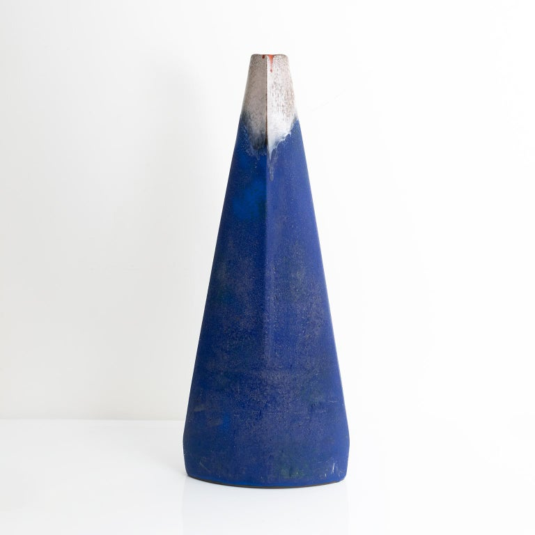 A very large Mid-Century Modern Azzirro vase in deeply saturated cobalt blue glaze with red and earthy colors around the opening. Mad by Ceramano-Kunstkeramik, Ransbach-Baumbach, West-Germany, circa 1960. 