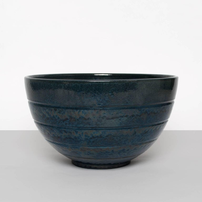 """Large Scandinavian Modern ceramic bowl by Jerk Werkmäster for Nittsjo in midnight blue glaze. Signed on bottom made between 1937-42. Diameter: 12"""", Height: 7""""."""