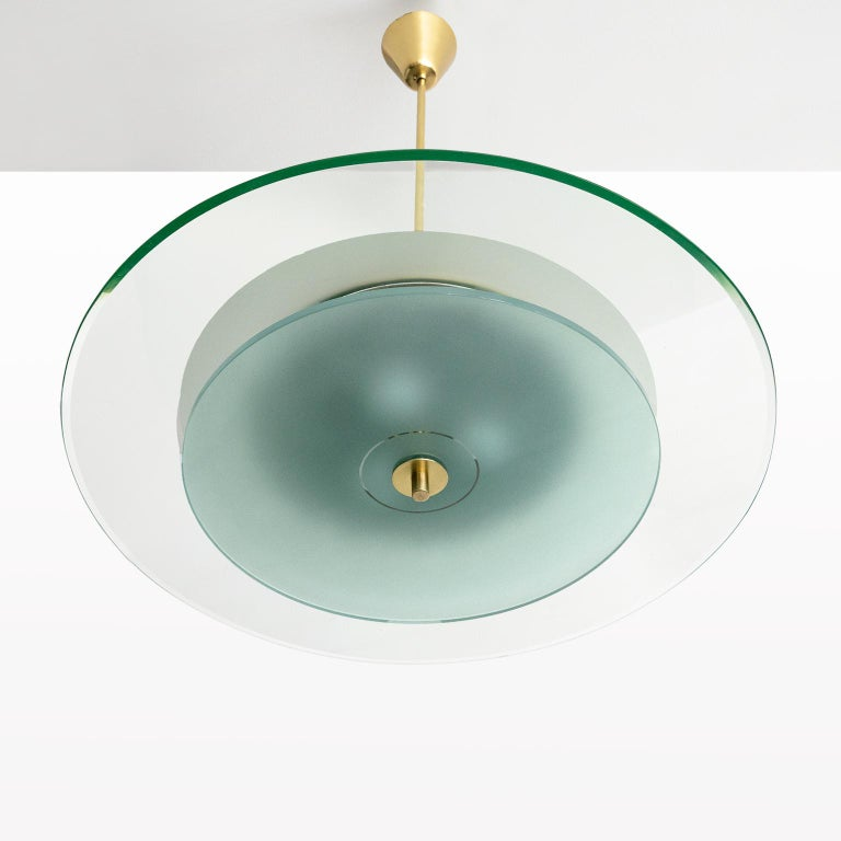 A sleek modernist glass and brass pendant fixture by the brilliant Pietro Chiesa for Fontana Arte, Milano, Italy, circa 1950. Newly rewired with standard base sockets detail with porcelain rings. Newly polished brass and original painted metal