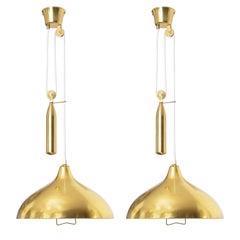 Scandinavian Modern Pair of Itsu Polished Brass Counterweight Pendants