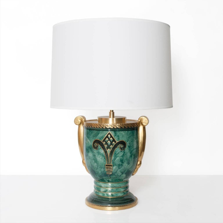 Scandinavian Modern ceramic table lamp in luster glaze with hand decorations in gold. Designed by Josef Ekberg for Gustavsberg, signed and dated 1928. Fitted with newly polished and lacquered brass hardware and a double socket cluster. Total height
