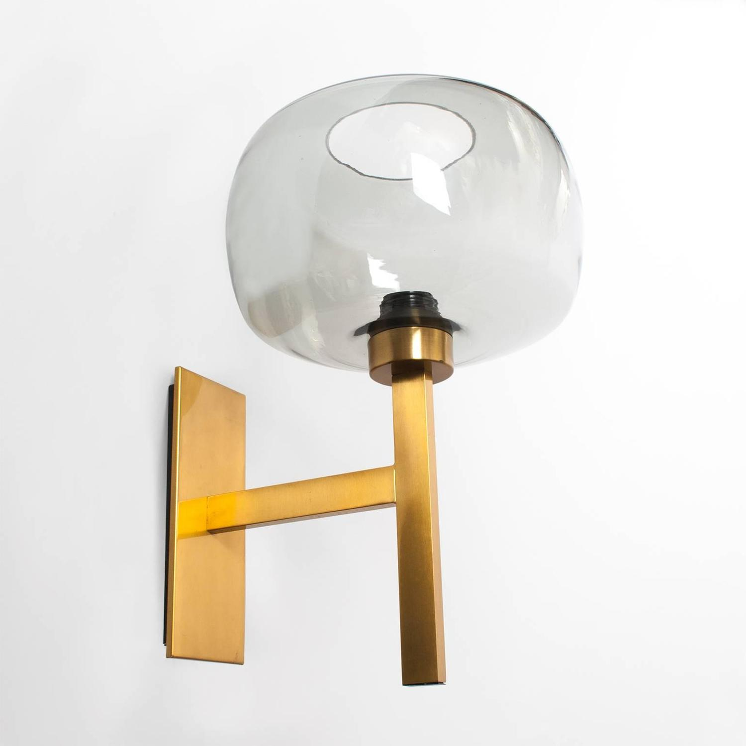 Pair of Scandinavian Modern brass sconces with gray glass shades. at 1stdibs