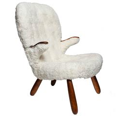 Scandinavian Modern armchair with sheepskin upholstery by Philip Arctander.