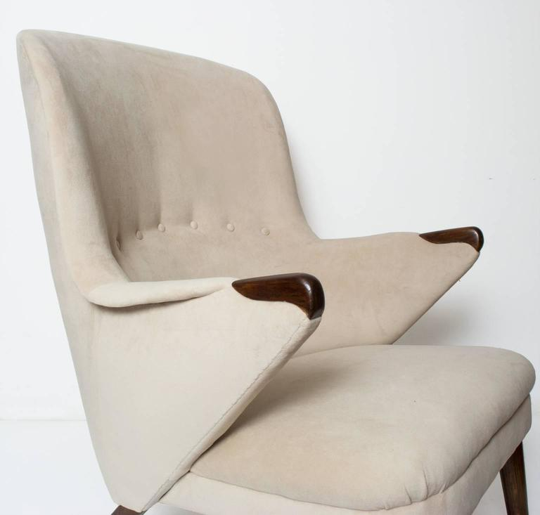 Scandinavian modern curved high back upholstered lounge chair with