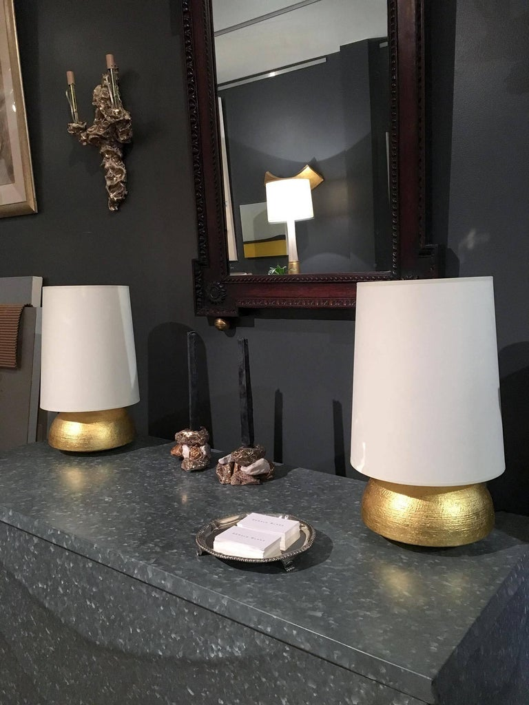 Pair of hand-coiled and gilded ceramic lamps with lampshades by Andrea Koeppel. Available as custom order.  Materials and techniques notes: Models of understated luxury, Koeppels gilt lamps are made in the hand-coiled tradition and fired with