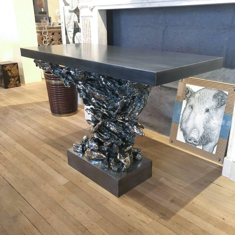 Gilded and glazed ceramic eagle form console with steel top and plinth