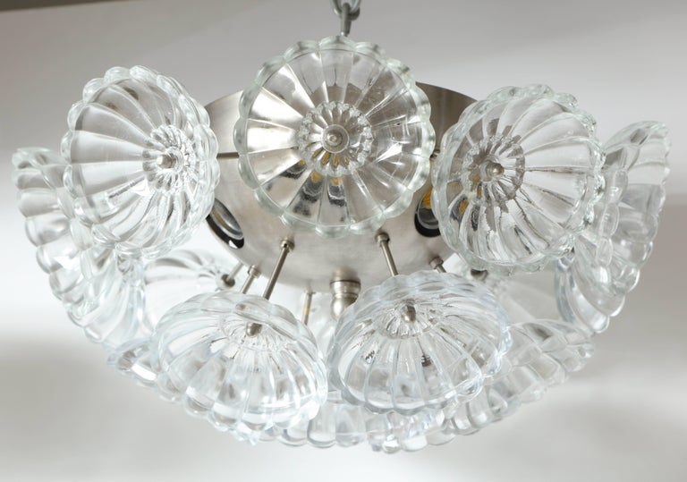 Midcentury flush mount chandeliers or sconces with stylized fluted glass elements on a satin nickel armature. Rewired for use in the USA, uses six chandelier type bulbs.  $1600 each.