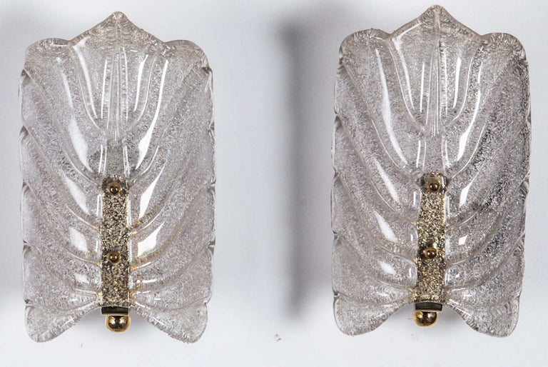 Pair of crystal stylized leaf sconces with a brass center stem by Orrefors, Sconces have been rewired for use in the USA.   Currently 2 pairs available.