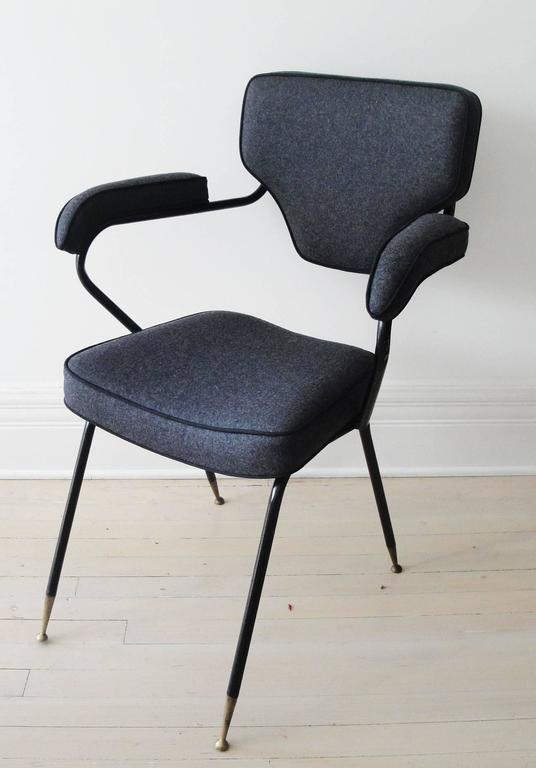 Italian chair feature gray upholstery and cantilever style bent metal base.