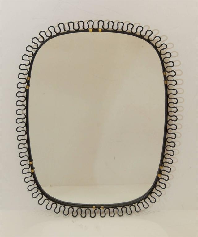 Well-shaped mirror in the style of Josef Frank, the black enameled frame with brass accents. Could also be used as a tray or plateau.