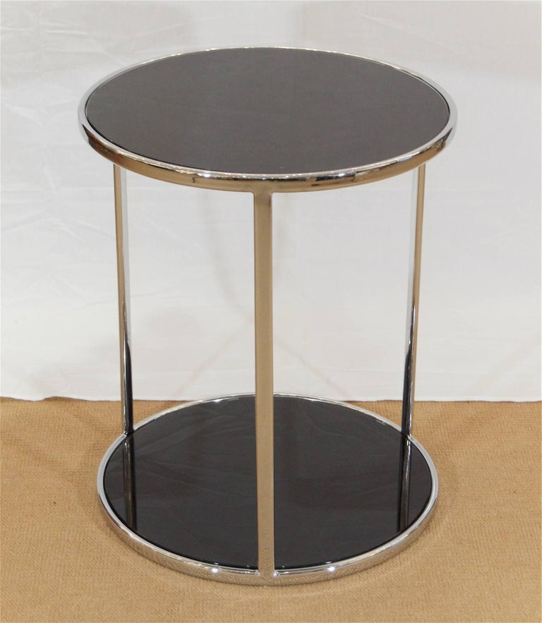 Well-sized side or cocktail table in chromed steel with black back-painted glass inserts; excellent finish quality.