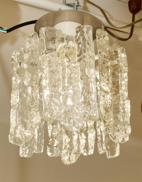 Fantastic petite ice glass flush mounted pendant with six pieces of glass.   Takes single medium base bulb, up to 100 watts. New wiring.  Due to structure of pendant drop height is not adjustable.