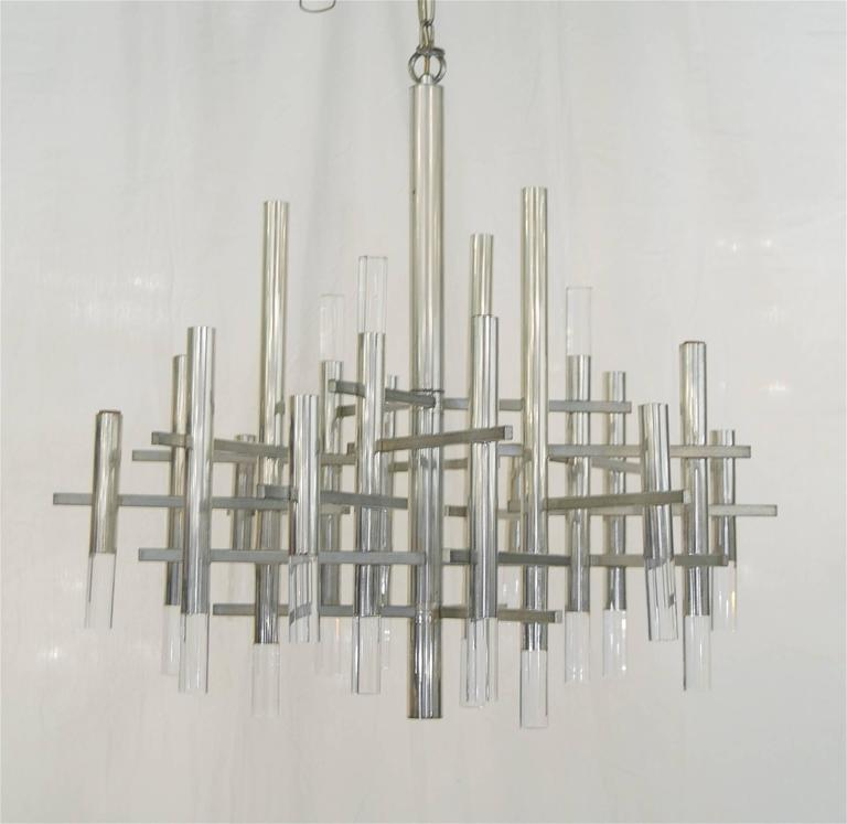 Substantially sized chrome and Lucite Sciolari chandelier.   Takes 15 candelabra base bulbs up to 40 watts per bulb. Original wiring. Height listed is of the chandelier body only. Overall drop height can be adjusted.