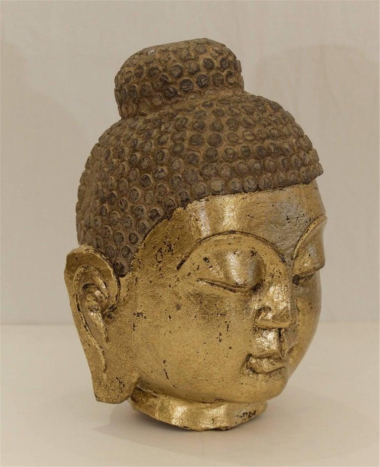 Carved stone gilt buddha head at stdibs