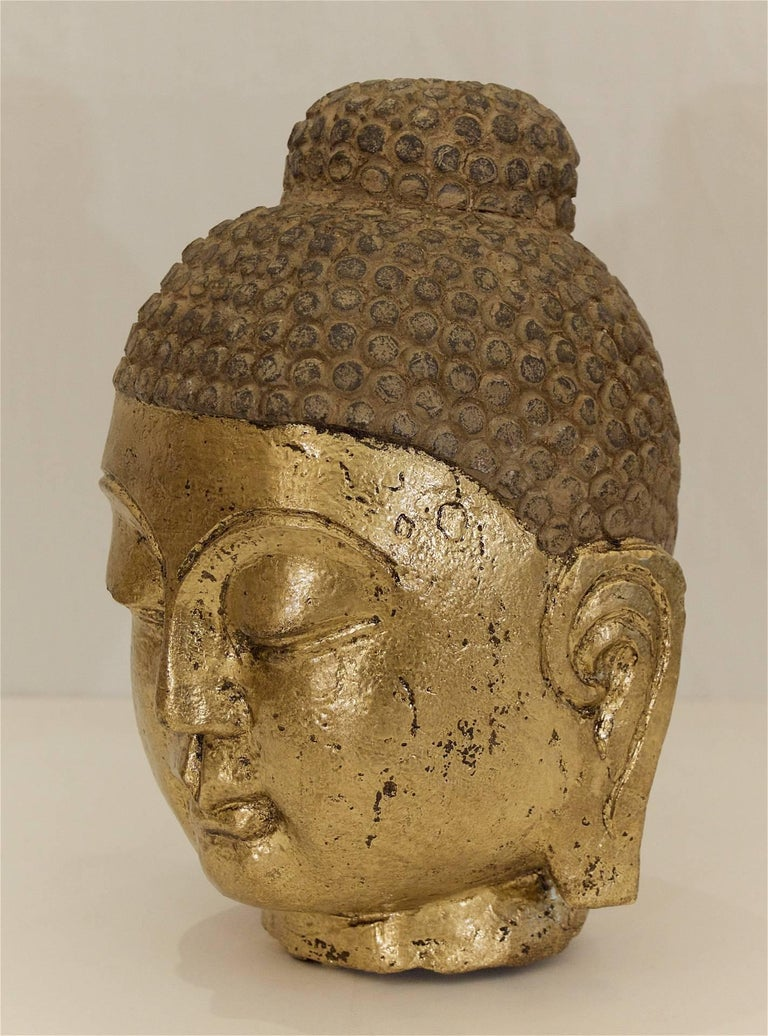 Carved stone gilt buddha head at stdibs