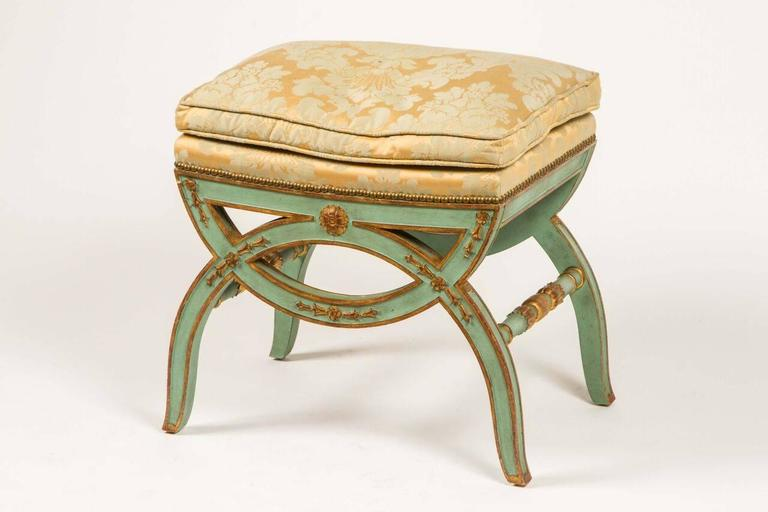 Simply lovely upholstered bench from the 19th century. Parcel-gilt and painted in a lovely misty green. Seat is upholstered in a silk damask. From estate of JP Morgan's daughter.