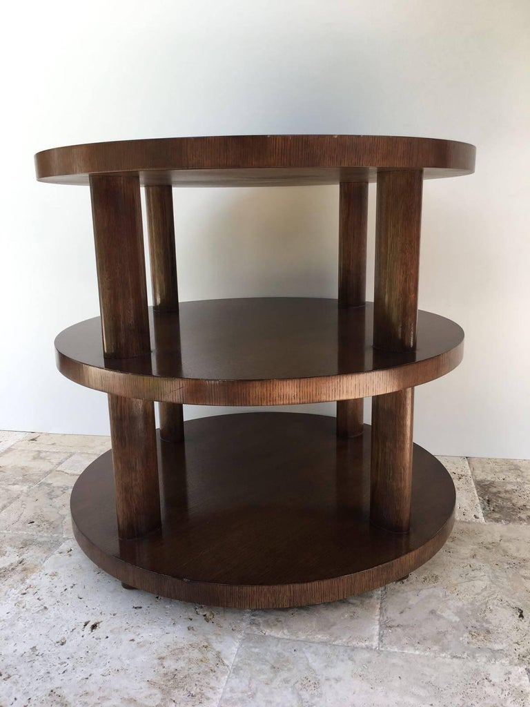 Inspired by a Charlotte Perriand design, this outstanding three-tiered table is solid mahogany with column details in the Art Deco style. Labelled to underside.