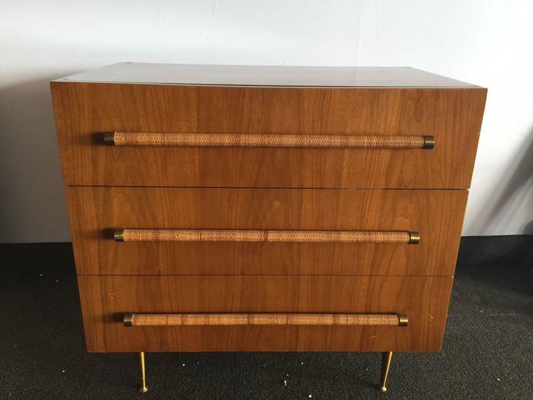 T.H. Robsjohn-Gibbings for Widdicomb three-drawer cabinet, 1960s, mahogany, brass, cane, signed with cloth Widdicomb label. Measure: 34.5'' W x 21.5'' D x 32.25'' H.