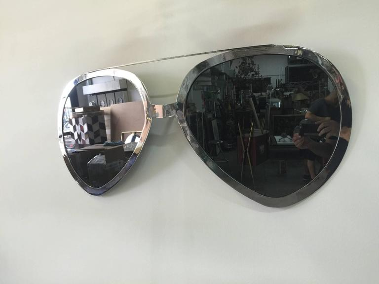 "Chrome trimmed and grey mirror - these oversized Aviators are a chic ""Rock-n-Roll"" statement."
