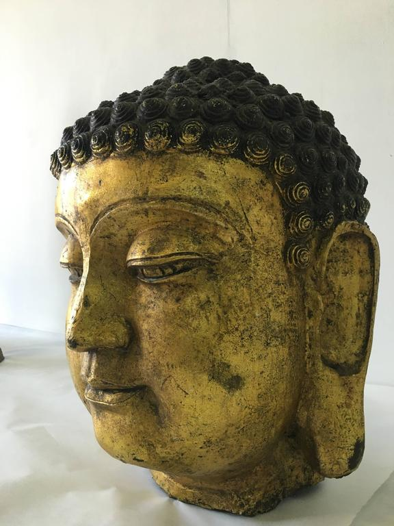 This is a very large and greatly detailed sculpture measuring 18 inches tall and 12 inches in diameter. All original and in perfect preserved antique condition. This peaceful image of Buddha from Laos/Thailand region adds simple elegance to any