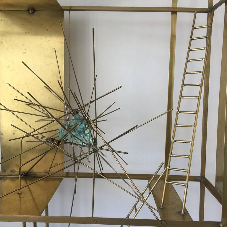 This custom original art piece by Gustavo Olivieri highlights a custom base pedestal and creative accents throughout. Aqua blue/green rock glass elements and petite brass ladders.  Dimensions of sculpture section only: 48 inches wide, 49 inches