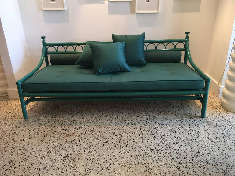 Henry Olko for Willow & Reed, this early production sofa is lacquered in the same green as the leather upholstery. Additional pillows in leather as shown in detail images are included.  Note: there is a matching armchair and side table available for
