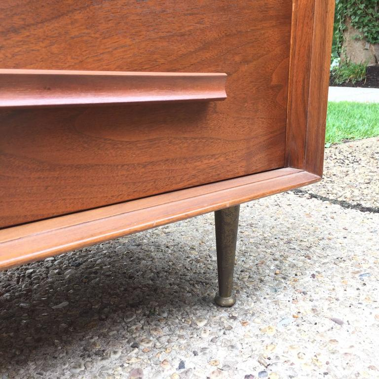 Beautiful tapered brass legs on this well-proportioned masculine dresser with three drawers. Very much in spirit of Gio Ponti.