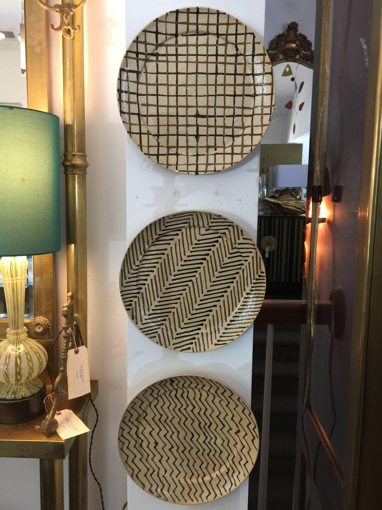 Each hand-painted plate is work of art, displayed in our showroom hung in a row. We have seven total - pictured are six unique designs. The seventh plate is a repeat.   My Hamilton confirmed to us that these plates were created prior to 1977 when he