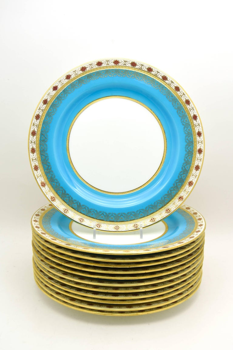 This is one of my exceptional sets of 19th century Minton dinner plates retailed by the illustrious Wilhelm and Graef, New York. They feature a rich, deep turquoise border, a clear white center and acid etched Greek key stylized gold bands, all