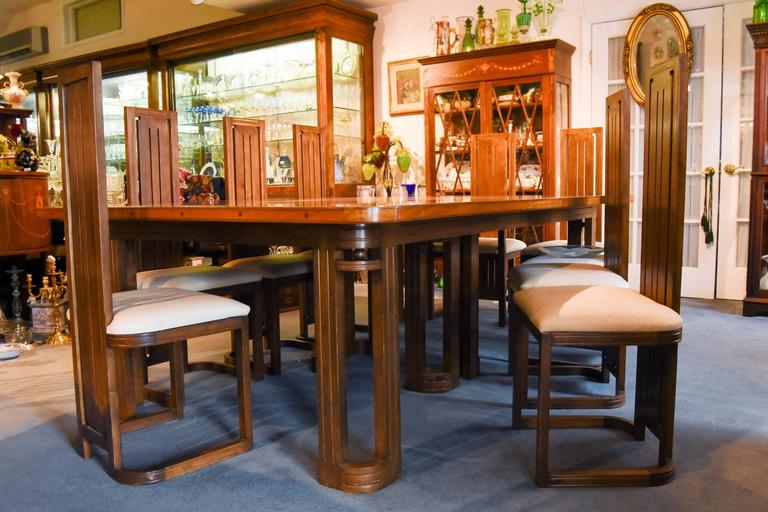 Arts and Crafts Frank Lloyd Wright-Style Dining Table with Twelve Matching Chairs, circa 1950 For Sale