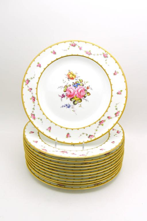This set is a great example of the iconic artistry and style of Royal Crown Derby.
