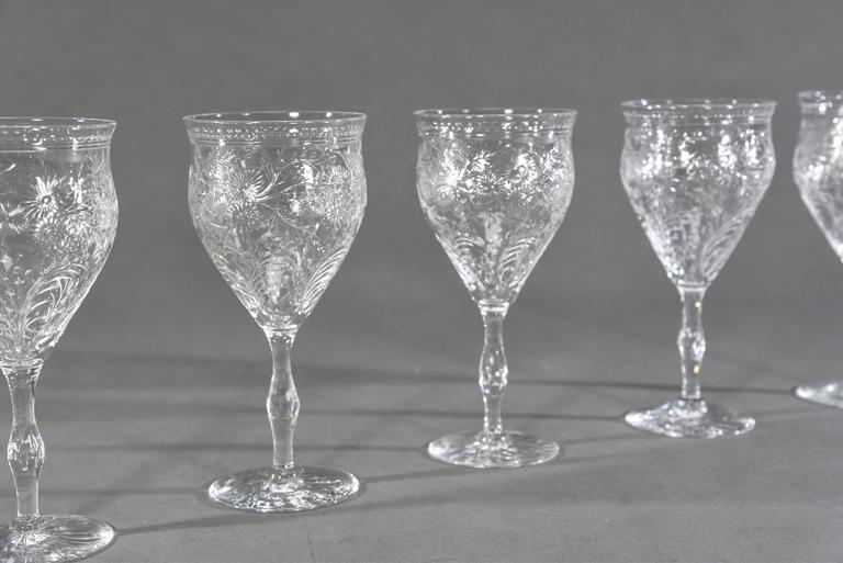 This set of 12 hand blown crystal goblets were made by Webb Corbett, England and are the perfect addition to your table setting. The nice large size makes these an excellent choice for use as a water goblet or wine goblet as they are large enough