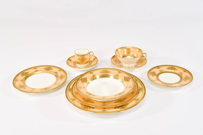 As we approach the holiday season, this complete Minton for Tiffany dinner service for 12 will work with many decorating themes to dress up any event. The warm butterscotch border frames a clean white center and is decorated with an elegant