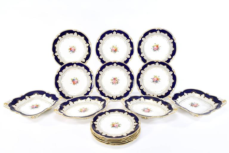 This 15 piece Royal Crown Derby dessert set consists of 11 9