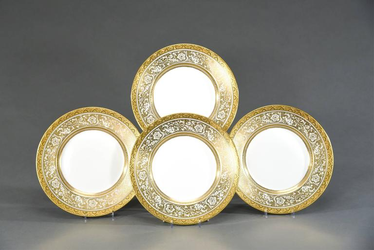 """One of Minton's most popular patterns is named """"Porcelain Ball"""" which features a large diameter plate bordered by a gold and white floral decoration and trimmed with an acid etched border. Made in the 1950s, these work well with many antique"""