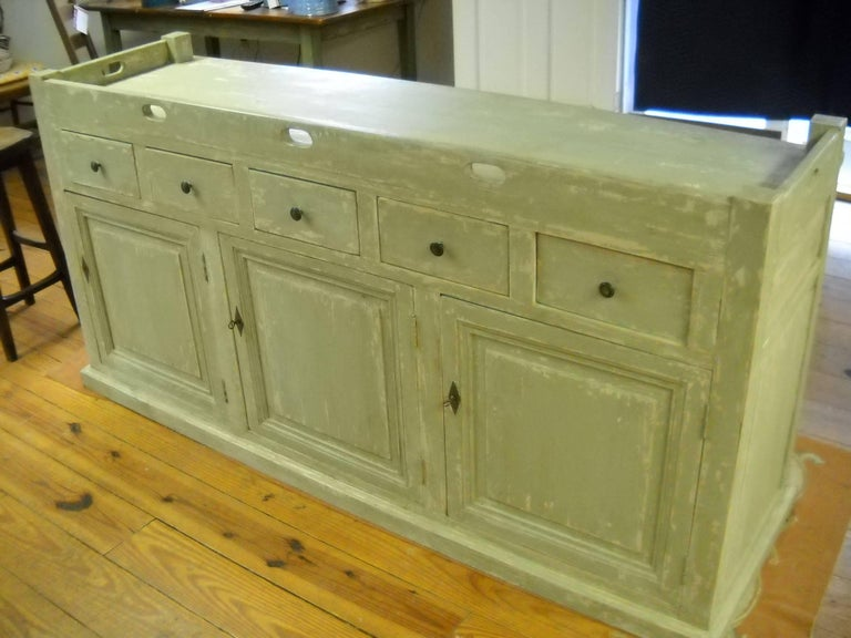 We by more store counters than anything in the store and this piece, from a French restaurant in the south of France is as special as any piece we have found in the last 3 years. There are three doors and five drawers on this piece. The three doors