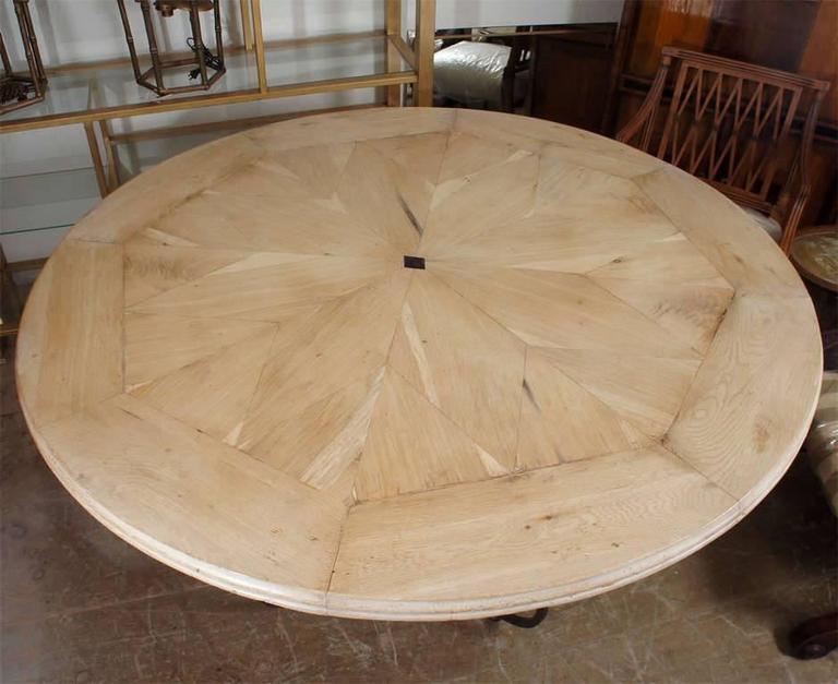 Stunning round bleached oak tabletop with starburst design and French Baroque style metal base dining table. Top and base can be sold separately. See detail photo to appreciate tabletop. Top 4000/Base 3500.