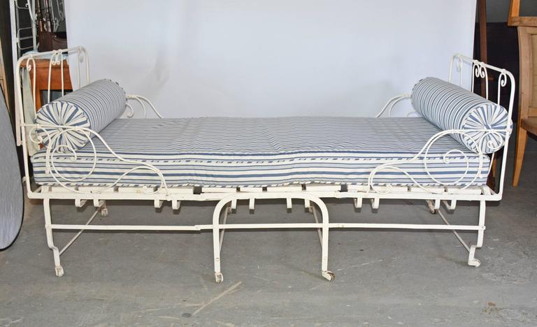 """19th century French Campaign bed that folds in the center for easy storage and be used when needed for extra company. See photo details.  When folded for storage, width measures 33""""."""