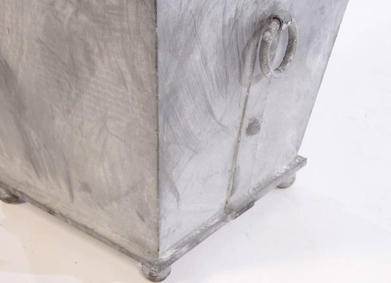 Two Pairs of Classic Regency style cast iron garden zinc colored planters available with rings in wonderful weather resistant lead grey color.  Priced per pair.  Search terms:  zinc planters, lead planters, Neo-classical style planters, Versailles