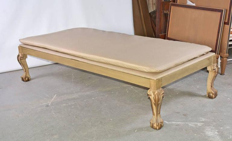 Elegant daybed has gilt ball-in-claw legs and a new cushion.