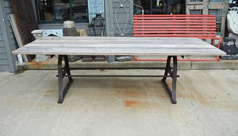 "Indoor or outdoor metal trestle base and teak wood top dining table. Top and base can be sold separately. Teak tabletop made from aged distressed wood. Great for use as patio or garden dining table.  Measure: Top 8'5"" x 39.5"" x 1.25"""